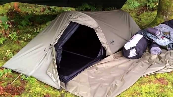 1 person solo tent setup in a pine forest