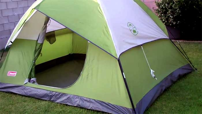 Tent for four people setup in a garden