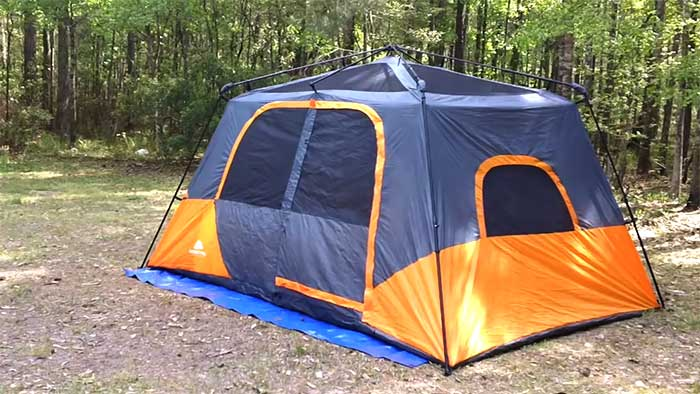8 person instant cabin setup on a camping ground