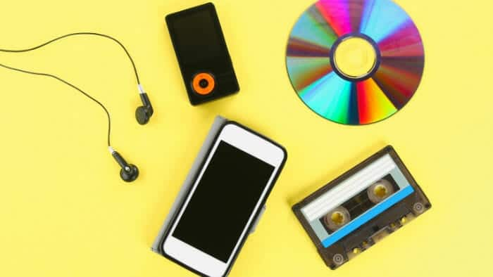cassette next to a phone and an mp3 player