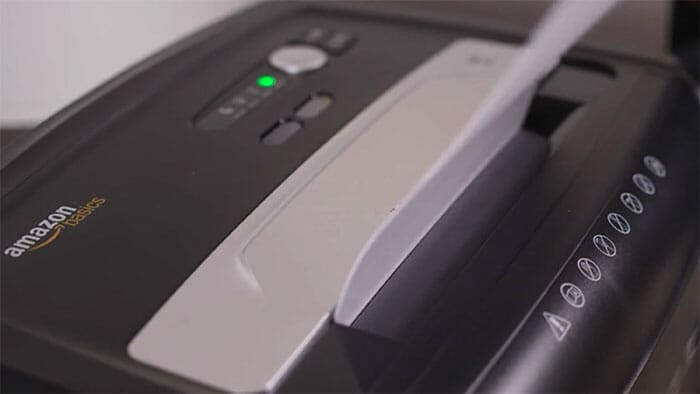 Amazon basics shredder shredding an invoice