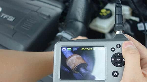 Camera inspecting a car's motor