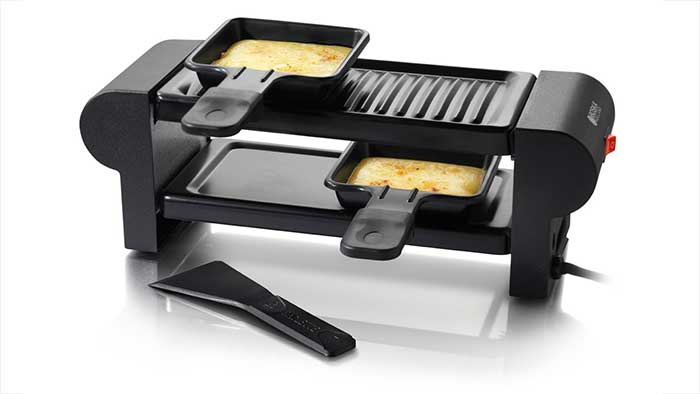 Cheese melting in a mini frying pan on a raclette party grill