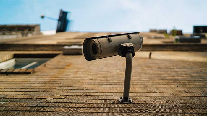 Home security camera on a walll