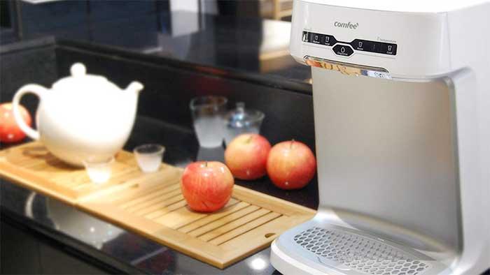 mini countertop water cooler next to apples