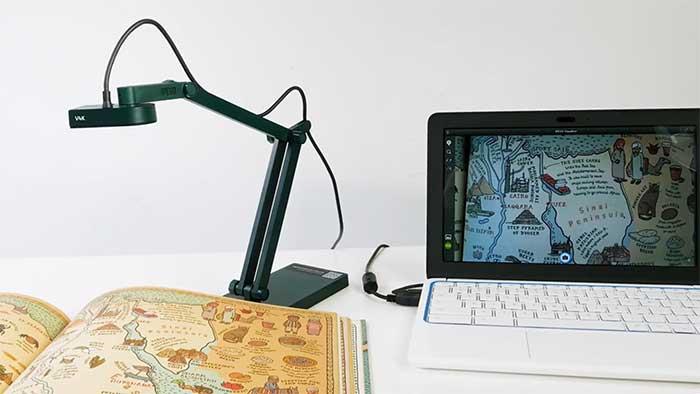 Big encyclopaedia under an overhead scanner