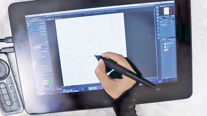 woman drawing a figure freehand style on a drawing display