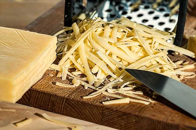 grated cheese on a wooden table