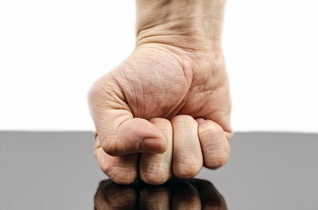 Fist pressed against the floor