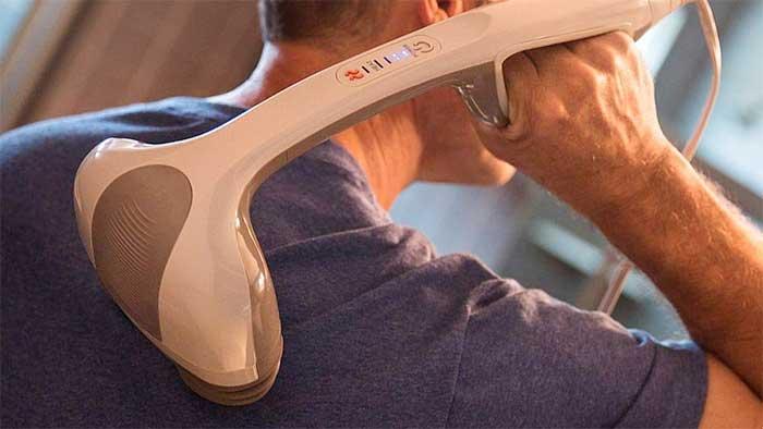 Man using a Homedics dual pivoting head massager