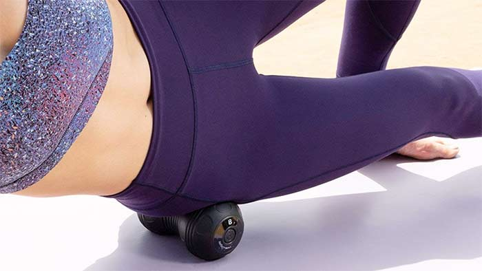 Woman using a massage roll to relax her muscles