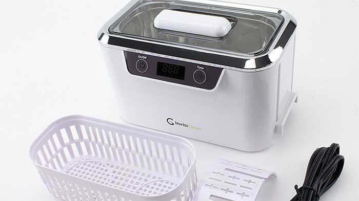 Invisiclean professional ultrasonic cleaner next to its basket
