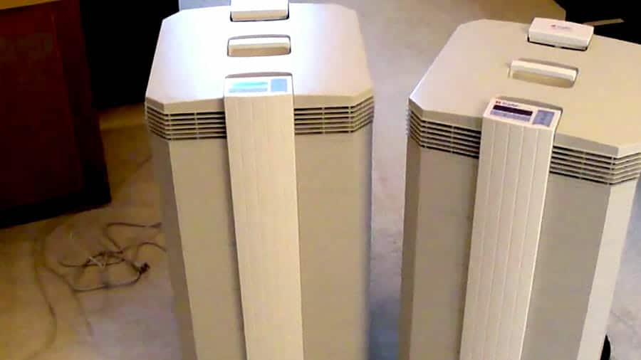 Two air purifiers in an office space