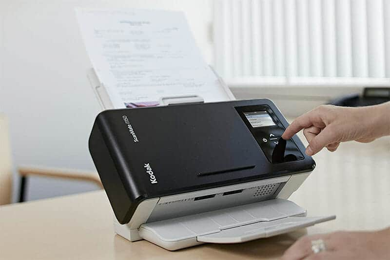 Kodak scanner with a document passing through the feeder