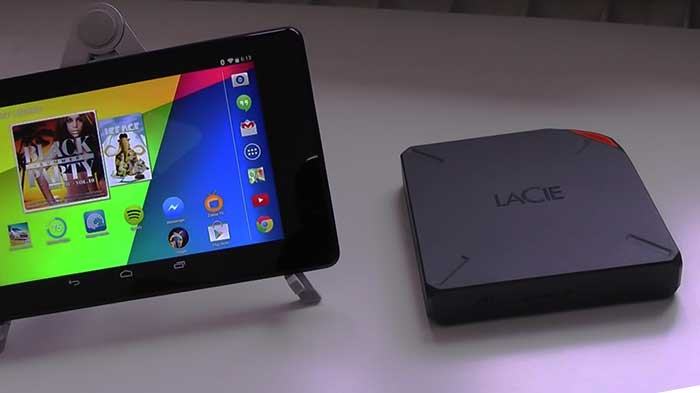 Lacie fuel 1TB external storage next to a tablet