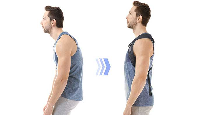 Man correcting his posture whith a back brace