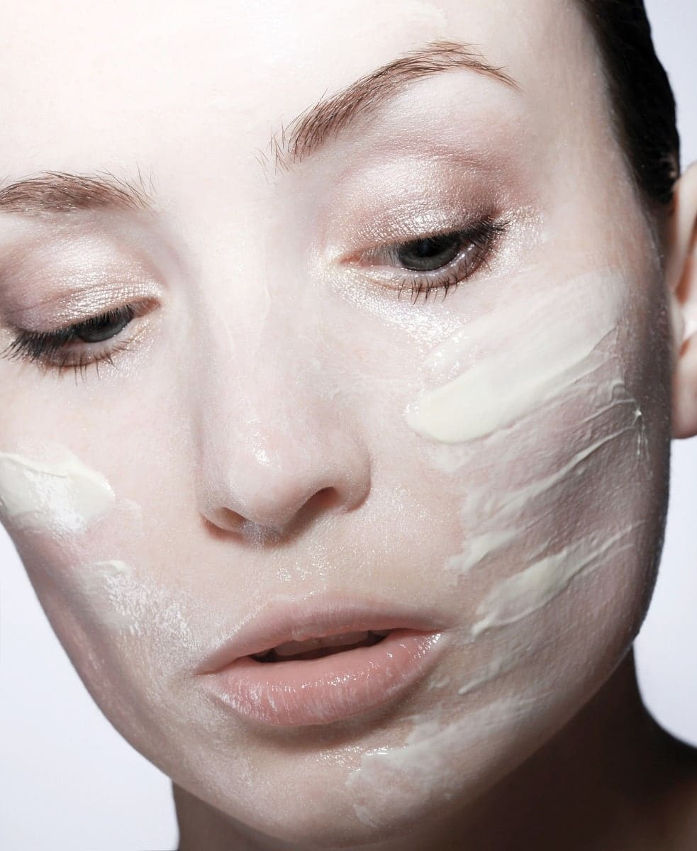 women applied moisture rich night cream image