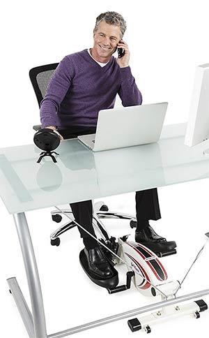 Office worker using an under desk elliptical