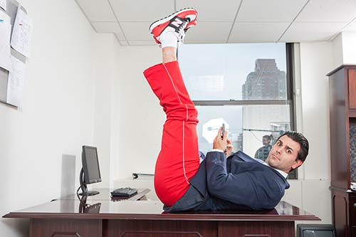 Business person exercising on his desk