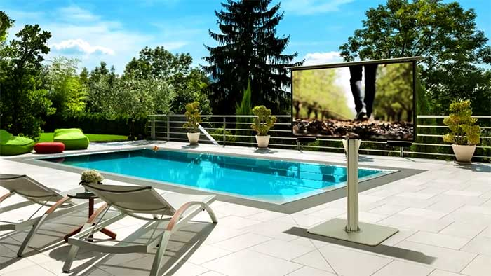 LED tv next to an open pool