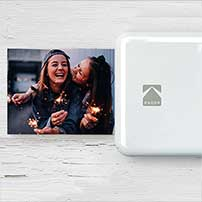 Portable printer printing a portait photograph