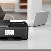 Printer next to a chromebook