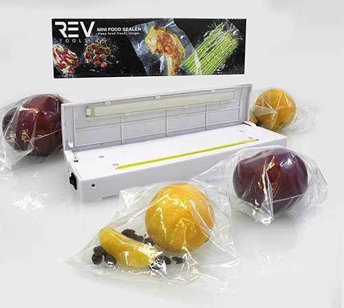Impulse food sealer next to fruits and vegatables sealed in plastic bags