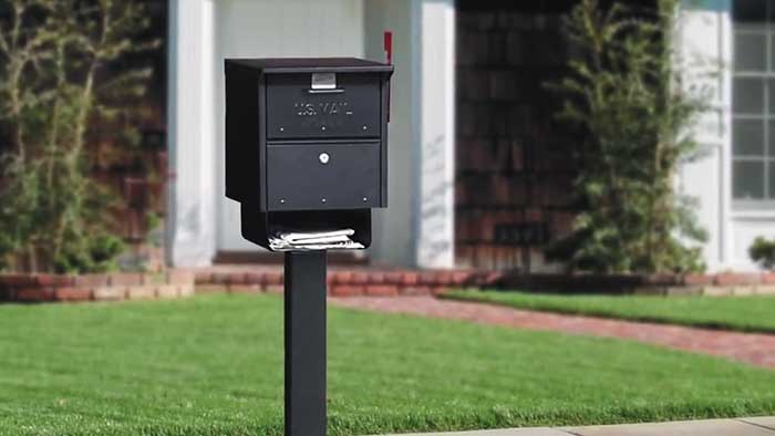 Salsbury industries roadside security mailbox in front of a house