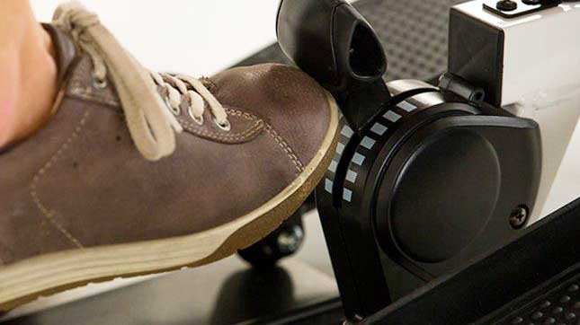 Shoe stepping on an elliptical trainer