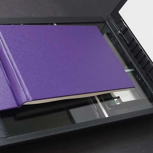 Art sketchbook in a scanner