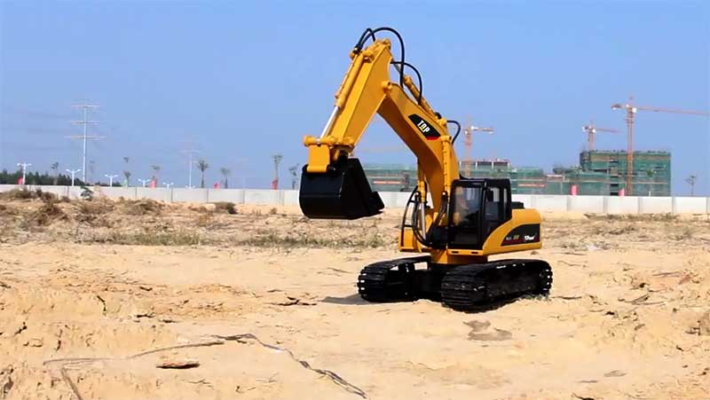 top race excavator toy on sand
