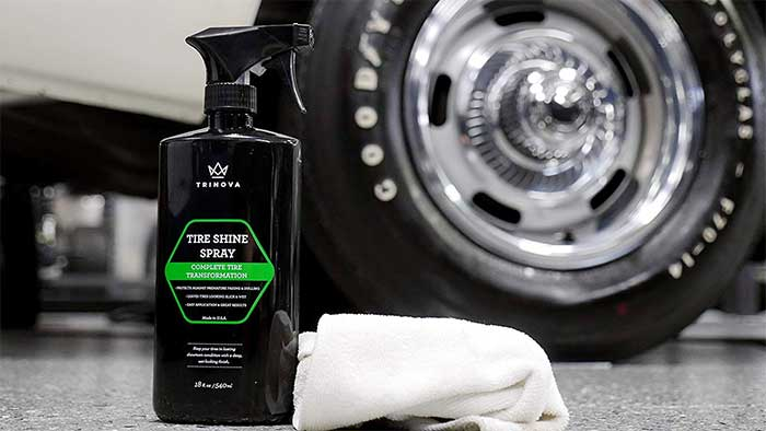 Trinova tire dressing spray next to a glossy car tire