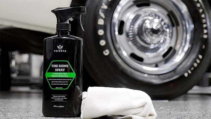 Trinova tire dressing spray next to a glossy car tire