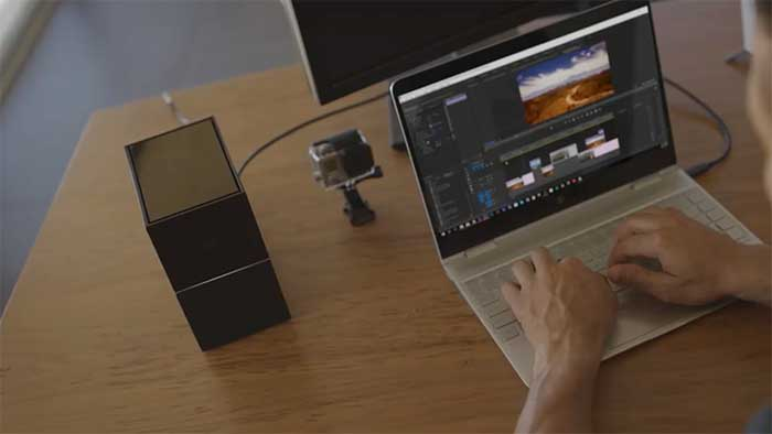 Video editing storage solution next to a laptop with a video editing software running