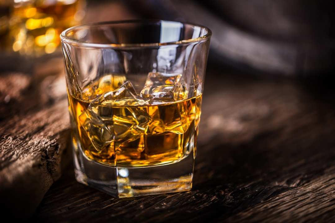 ice cubes in a glass of whiskey