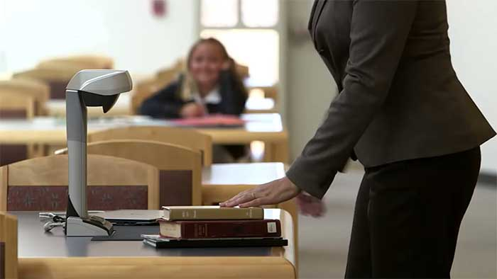 Woman scanning books in an office environment