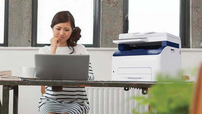Xerox machine next to an office worker
